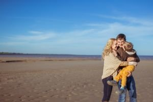 family on beach in fall